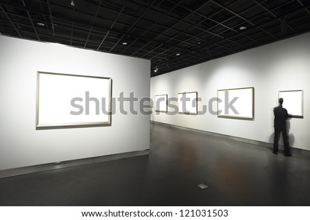 frames on white wall in art museum - stock photo