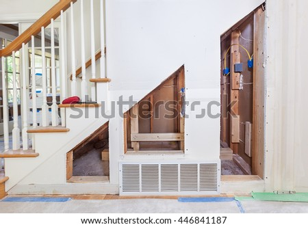 Framing and supports for under stair pullout storage cabinets - stock photo