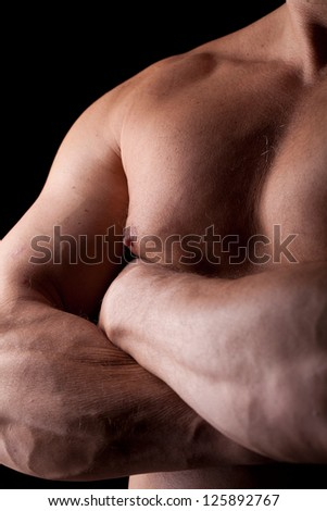 framing closed trunk of a muscled man - stock photo