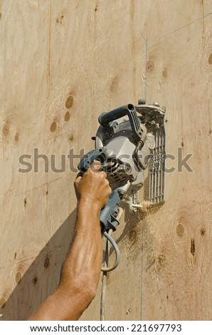 Framing construction contractor installing sub siding on a wood frame wall of a new luxury custom home - stock photo