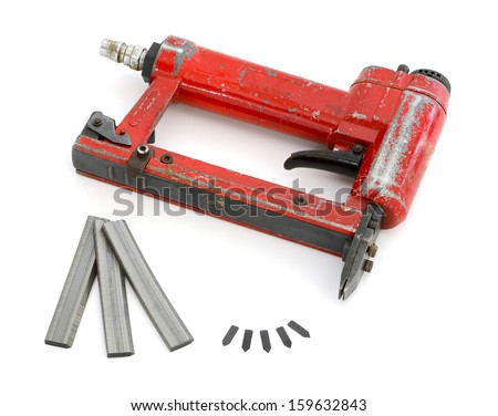 Framing tools. Nail gun. - stock photo