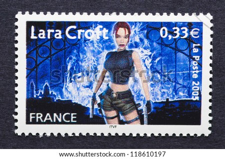 FRANCE - CIRCA 2005: a postage stamp printed in France showing an image of Lara Croft a character of Tomb Raider video game, circa 2005. - stock photo