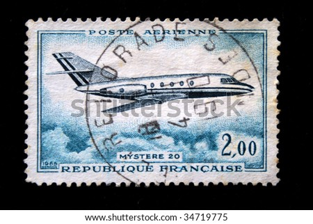 FRANCE - CIRCA 1965: a stamp printed by France show the passenger jet Mistere 20 circa 1965. - stock photo
