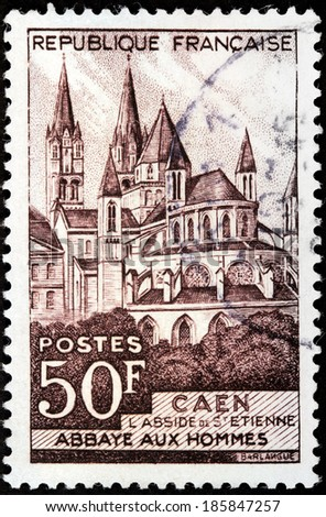 FRANCE - CIRCA 1951: A stamp printed by FRANCE shows Abbey of Saint-Etienne in Caen town. Caen is prefecture of Calvados department and the capital of Basse-Normandie region Normandy, circa 1951 - stock photo
