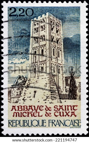 FRANCE - CIRCA 1985: A stamp printed by FRANCE shows Abbey of Saint Michel de Cuxa - Benedictine abbey located in Codalet, Pyrenees-Orientales, in southwestern France, circa 1985 - stock photo