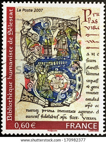 FRANCE - CIRCA 2007: A stamp printed by FRANCE shows image of  illuminated initial of the Livre des Miracles de Sainte-Foy written by Bernard episcopal schoolmaster of Angers, circa 2007 - stock photo