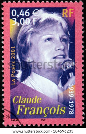 FRANCE - CIRCA 2001: A stamp printed by FRANCE shows image portrait of famous French pop singer, songwriter and dancer Claude Francois also known by the nickname Cloclo, circa 2001 - stock photo