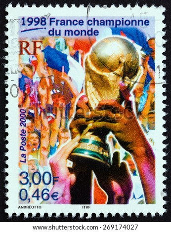 "FRANCE - CIRCA 2000: A stamp printed in France from the ""Sport Events of the 20th Century "" issue shows Football World Cup Trophy (France, World Champions, 1998), circa 2000.  - stock photo"