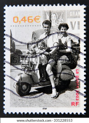 FRANCE - CIRCA 2002: A stamp printed in France shows a family in a beautiful summer, Saint-Brevin-les-Pins (Loire Atlantique), 1.955, circa 2002 - stock photo