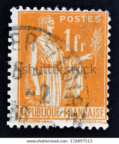 FRANCE - CIRCA 1932: A stamp printed in France shows a woman with an Olive Branch in hand - allegory of Peace, circa 1932  - stock photo