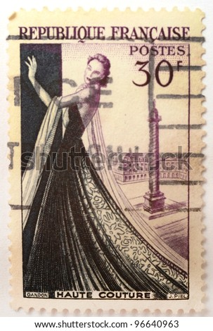 FRANCE - CIRCA 1953: a stamp printed in France shows image commemorating haute couture (high fashion), in hommage to Christian Dior, circa 1953 - stock photo
