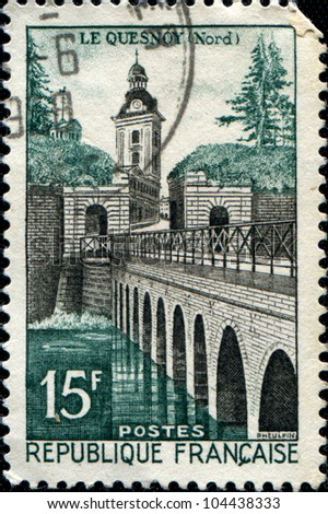 FRANCE - CIRCA 1957: A stamp printed in France, shows the Le Quesnoy, castle and bridge, circa 1957 - stock photo