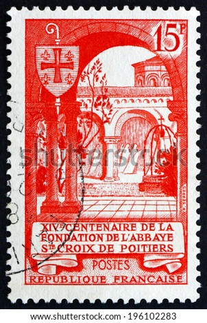 FRANCE - CIRCA 1952: a stamp printed in the France shows Abbey of the Holy Cross, Poitiers, 14th Centenary of the Foundation of the Abbey of the Holy Cross at Poitiers, circa 1952 - stock photo