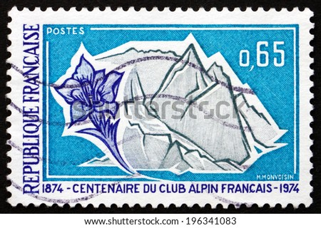 FRANCE - CIRCA 1974: a stamp printed in the France shows French Alps and Gentian, Centenary of the French Alpine Club, circa 1974 - stock photo