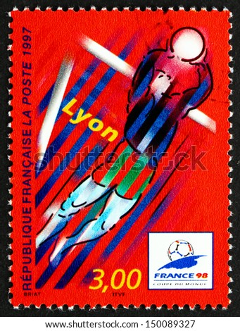FRANCE - CIRCA 1997: a stamp printed in the France shows Lyon, Host City of 1998 World Cup Soccer Championships, Stylized Action Scene, circa 1997 - stock photo