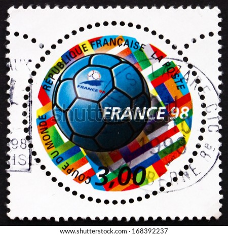 FRANCE - CIRCA 1998: a stamp printed in the France shows Soccer Ball and Flags, 1998 World Cup Soccer Championships, France, circa 1998 - stock photo