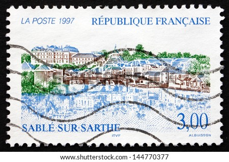 FRANCE - CIRCA 1997: a stamp printed in the France shows View of Sable-Sur-Sarthe, Commune in the Sarthe Department in the Pays de la Loire Region, circa 1997 - stock photo