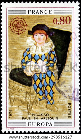 FRANCE - CIRCA APRIL, 1975: A stamp printed by FRANCE shows painting Paul as Harlequin by Pablo Ruiz y Picasso, also known as Pablo Picasso - stock photo