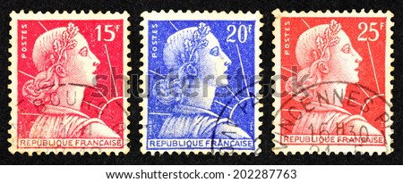 FRANCE - CIRCA 1955: Series of colorful postage stamp printed in France with image of Marianne, the national emblem of France and an allegory of Liberty and Reason. - stock photo
