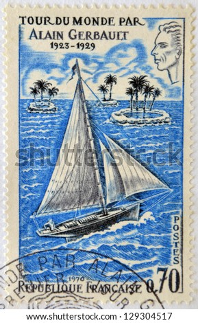 FRANCE - CIRCA 1970: Stamp printed in France dedicated to Alain Gerbault, who made a circumnavigation of the world as a single-handed sailor, circa 1970 - stock photo