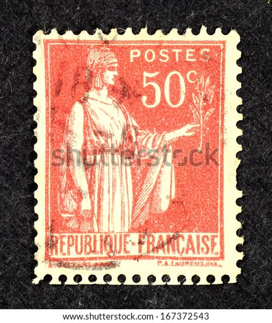 FRANCE - CIRCA 1921: Stamp printed in France with image of Marianne Semeuse, the national emblem of France and an allegory of Liberty and Reason, circa 1921. - stock photo