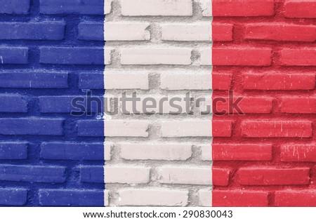 France flag on brick wall - stock photo