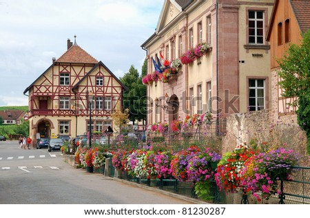 France, Mayoralty building decorated with flowers in Riquewihr - stock photo
