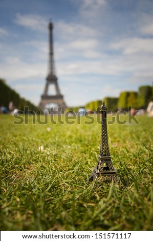 FRANCE - PARIS - 15 AUGUST 2013 - miniature of the Eiffel tower to the true Eiffel - stock photo
