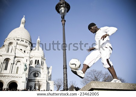 FRANCE, PARIS - DECEMBER 28: STREET SHOW, Iya Traore - Football Freestyler for the top event for the for the trade and user at the Montmartre District, December 28, 2009 in Paris, France. - stock photo