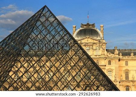FRANCE. PARIS - JUNE 25, 2015: View on the Louvre Museum and the glass pyramid on a summer evening. - stock photo