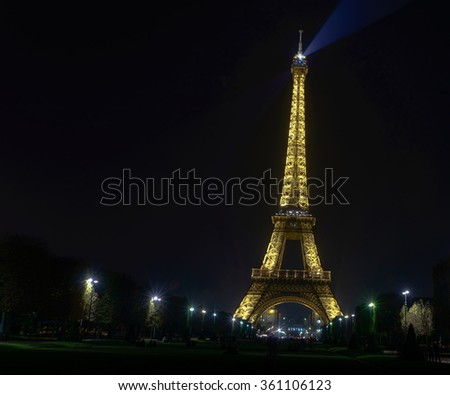 France , Paris- 31 October 2015 :Eiffel Tower shows its wonderful lights at sunset with car light trails in Paris. It is lit by more than 350 lamps mounted within the structure of the tower - stock photo