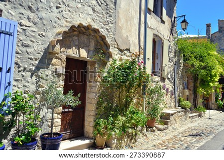 France, Provence. Typical street with medieval houses surrounded a green plant. Vaison la Romaine - stock photo