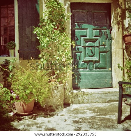 France, Provence. Vaison la Romaine. Typical medieval houses decorated with green plant and flowers in pots. Filtered image, vintage effect applied - stock photo