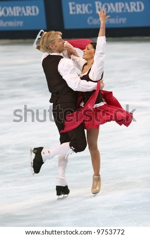 France's ice dancers Isabelle Delobel and Olivier Schoenfelder perform original dance during the ISU Grand Prix in Paris. This is pairs original dance as of season 2007/2008. - stock photo