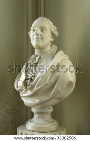 France, Versailles palace, Petit Trianon, statue of the king Louis XVI - stock photo