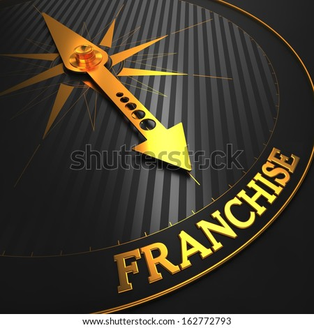 """Franchise - Business Concept. Golden Compass Needle on a Black Field Pointing to the Word """"Franchise"""".  - stock photo"""