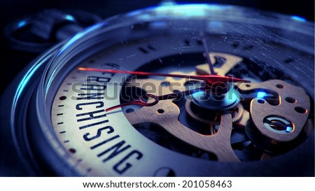Franchising on Pocket Watch Face with Close View of Watch Mechanism. Time Concept. Vintage Effect. - stock photo