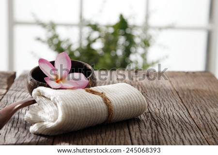 frangipani flower ,hand towel and coconut shell with handle - stock photo