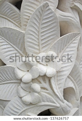 Frangipani flower motifs on the wall  - stock photo