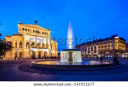 Frankfurt Alte Oper old opera with fountain at night - stock photo