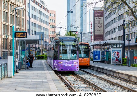 FRANKFURT AM MAIN, GERMANY - APRIL 30, 2016: An electric tram passing by the Downtown Hall an the Baseler platz square.  - stock photo