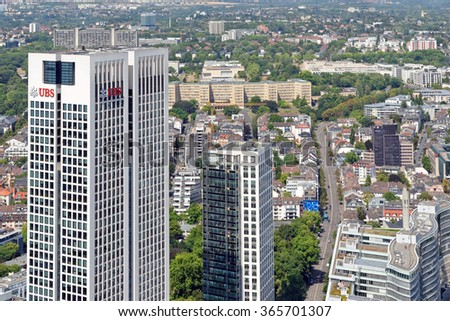 FRANKFURT AM MAIN, GERMANY - AUGUST 6, 2015: Aerial view of Opernturm and Park Tower skyscrapers from the Main Tower. Frankfurt is the largest financial centre in continental Europe. - stock photo