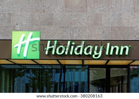 FRANKFURT AM MAIN, GERMANY - AUGUST 5, 2015: Holiday Inn hotel sign and logo. Holiday Inn is a multinational brand of hotels, part of the British InterContinental Hotels Group. - stock photo