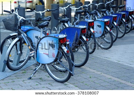 FRANKFURT AM MAIN, GERMANY - AUGUST 7, 2015: Nextbike bicycle rental station in the Frankfurt Trade Fair district near Messeturm. - stock photo