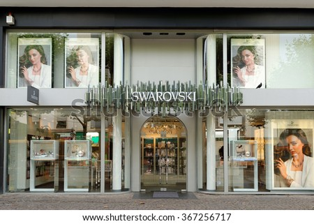 FRANKFURT AM MAIN, GERMANY - AUGUST 6, 2015: Swarovski store on Kalbacher Gasse street. The Swarovski Crystal range includes home decoration objects, jewelry and couture, and chandeliers. - stock photo