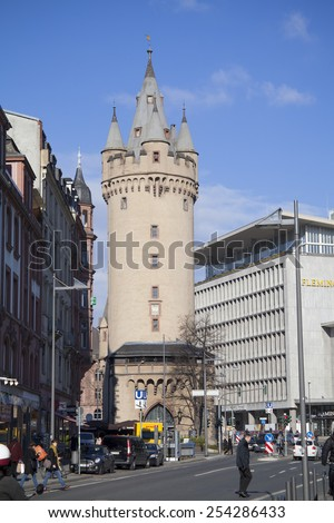 FRANKFURT AM MAIN, GERMANY - FEBRUARY 5, 2015: Eschenheim Tower is the oldest and most unaltered building in the largely reconstructed new town of Frankfurt.  - stock photo