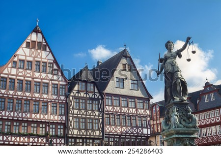 FRANKFURT AM MAIN, GERMANY - FEBRUARY 5, 2015: photo of statue of Lady Justice, known as the Roman goddess of Justice. Photo taken on February 5, 2015 in Frankfurt am Main city, Germany.  - stock photo