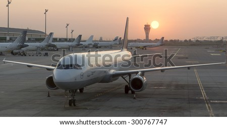 FRANKFURT AM MAIN, GERMANY - JULY 16, 2015: Aircrafts at the gate in Terminal 1 in Frankfurt, Germany. Terminal 1 was completed in 1972 and houses Lufthansa and other Star Alliance partners. - stock photo