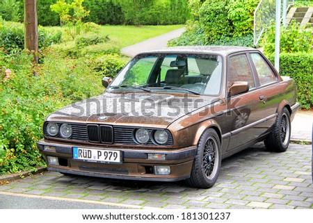 FRANKFURT AM MAIN, GERMANY - SEPTEMBER 16, 2013: Brown BMW E30 3-series retro car at the city street. - stock photo
