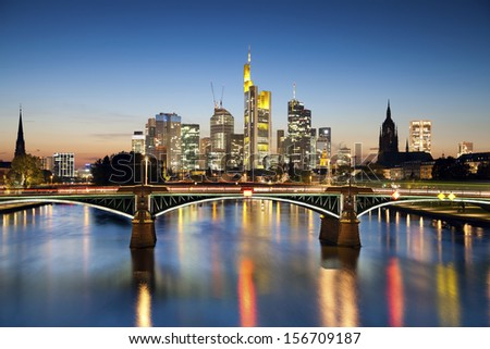 Frankfurt am Main. Image of Frankfurt skyline during sunset blue hour. - stock photo